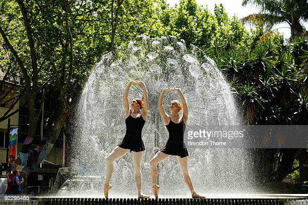 Two members of The Trocks the all male ballet company from New York dance in Kings Cross fountain on October 23 2009 in Sydney Australia Les Ballets...
