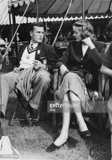 Two members of the US Olympic team chatting at Henley-on-Thames in England during the rowing event in the 1948 Summer Olympics, the XIVth Olympiad,...