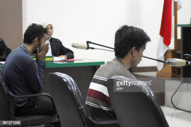 Two men accused of having sex in contravention of sharia law appear in court in Banda Aceh on May 10 2017 Prosecutors in Indonesia's Aceh on May 10...