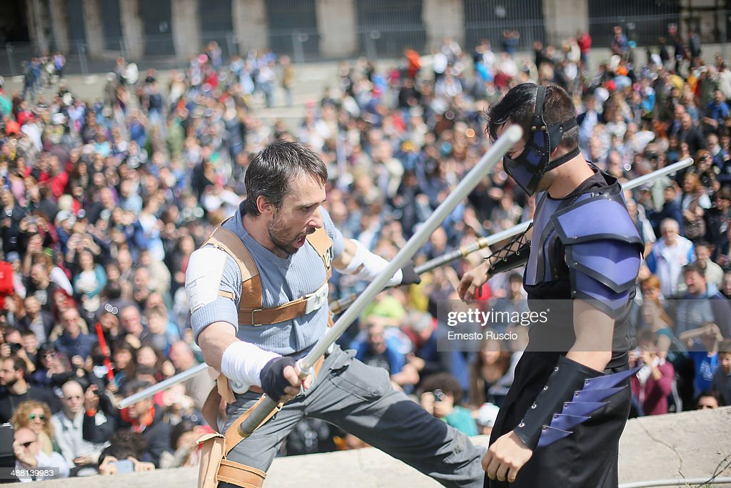 Two men act out a fight during the Star Wars Day 2014 at Colloseo on May 4, 2014 in Rome, Italy.