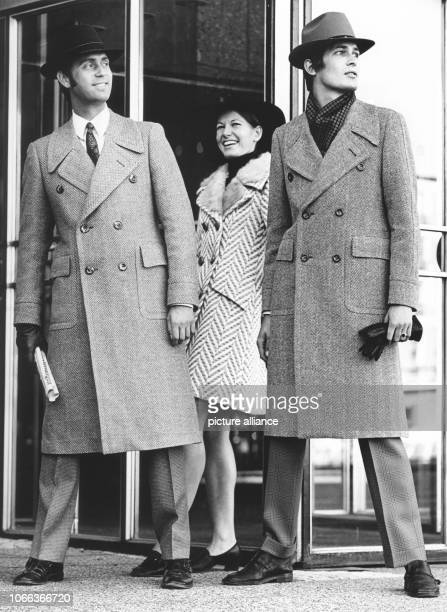 Two men and a woman are presenting contemporary clothes of the 1960s at the German institute for men's fashion on 23 September 1969 in Cologne |...