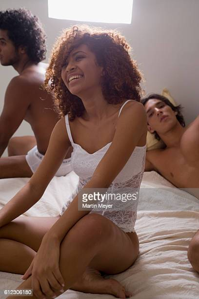 two men and a woman in the bedroom - libertinage trio photos et images de collection