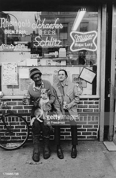 Two men and their dog outside a deli in Greenwich Village New York 1975