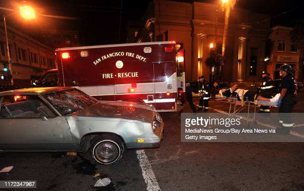 Two men are carried to an ambulance at 21st and Valencia after the World Series celebration turned violent in the city's Mission District late Monday...