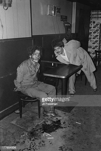 Two men are handcuffed and arrested after being caught fighting in a bar in Alphabet City New York City 1978