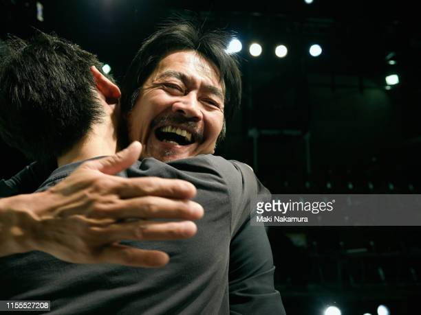 two men are hugging and celebrating joy - embracing ストックフォトと画像