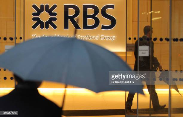 Two men are pictured in a branch of the Royal Bank of Scotland in London on January 22 2010 Share prices in statecontrolled banks Royal Bank of...
