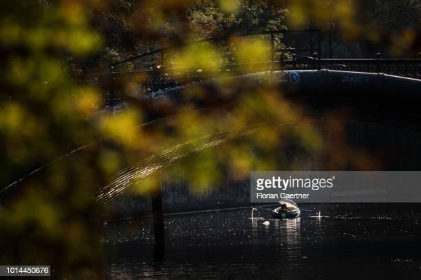 Two men are pictured in their dinghy on August 09, 2018 in Berlin, Germany.