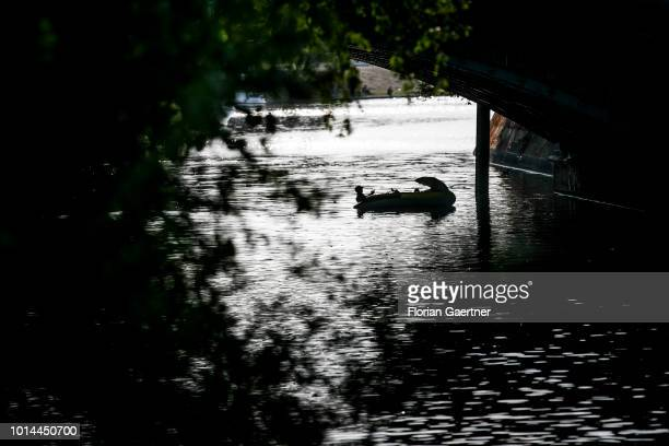 Two men are pictured in their dinghy on August 09 2018 in Berlin Germany