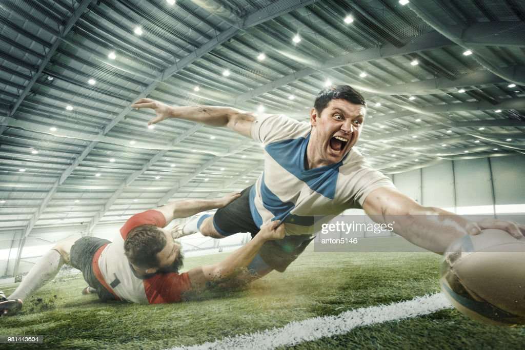 Two men are playing rugby and they compete with each other : Stock Photo