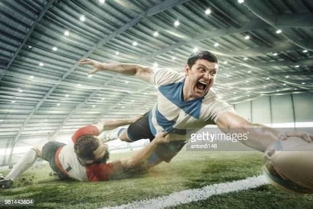 two men are playing rugby and they compete with each other - try scoring stock pictures, royalty-free photos & images