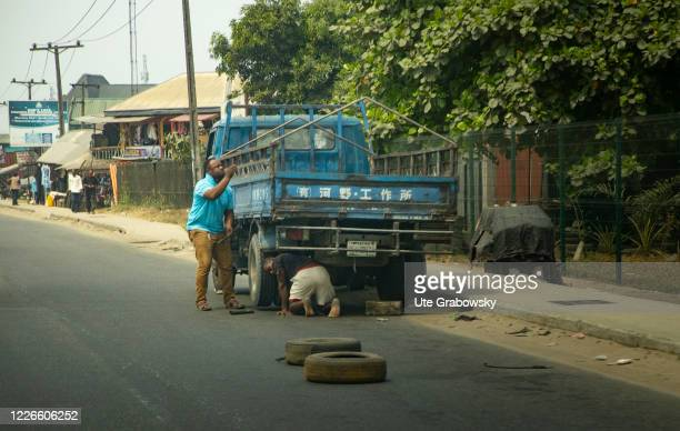 Two men are repairing a truck that has Chinese marks on February 05 2020 in Port Harcourt Nigeria