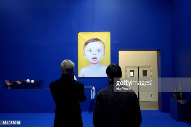 Two men are watcing a piece of art by Camille Henrot in Palais De Tokyo in Paris France on November 24 2017