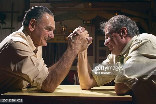 Two men arm wrestling, close-up