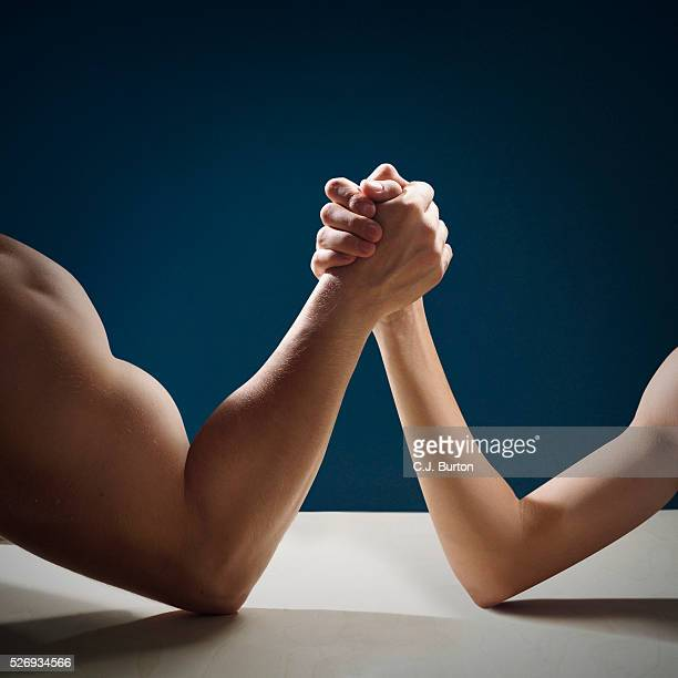 two men arm wrestling - irony stock pictures, royalty-free photos & images
