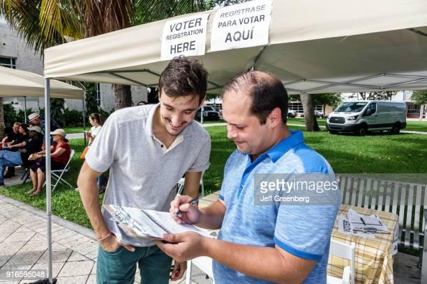 Two men at a voter registration at Collins park