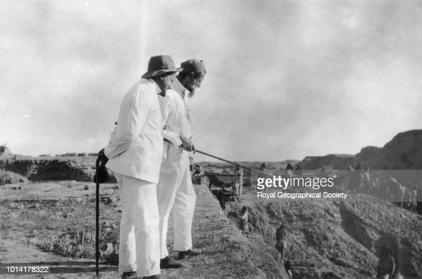 Two men at Babylon This photograph is likely to be of Gertrude Bell's 1914 visit to the archaeological site at Babylon The men pictured are probably...