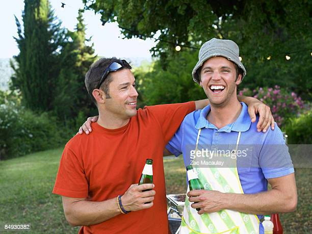 Two men at barbecue