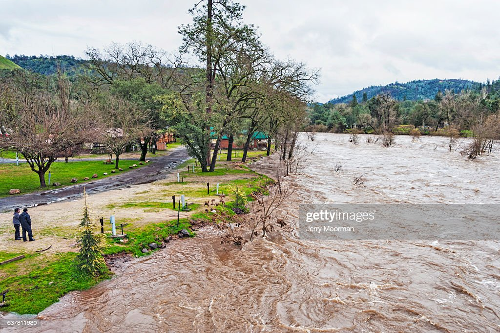 Two men at Coloma Campground watch American River High Waters : Stock Photo