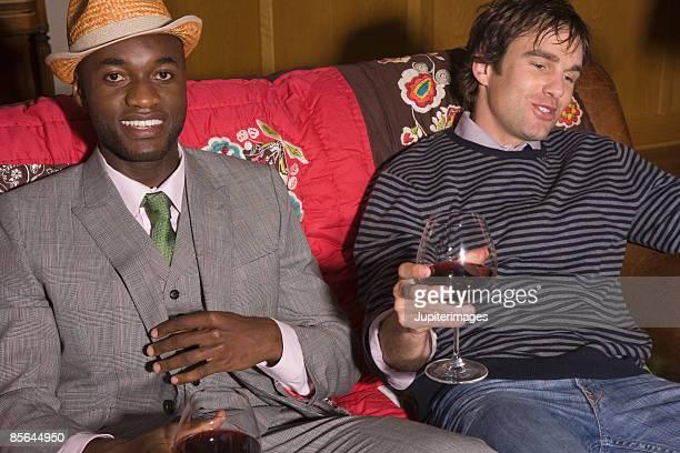 two men at party - グレンチェック ストックフォトと画像