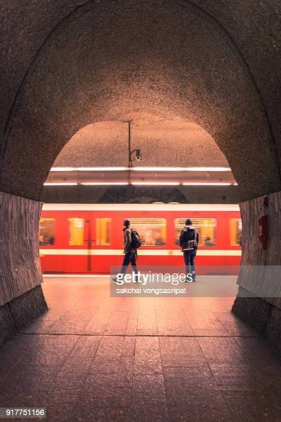 two men at subway station, nuremberg city, germany - space station photos et images de collection