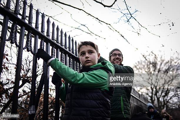 Two men attend a protest held in solidarity with the Washington DC Women's March in Dublin Ireland on January 21 2017