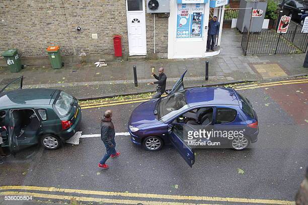 Two men brandishing an axe and a knife threaten each other in the street in Stratford on May 31 2016 in London England The altercation happened in...