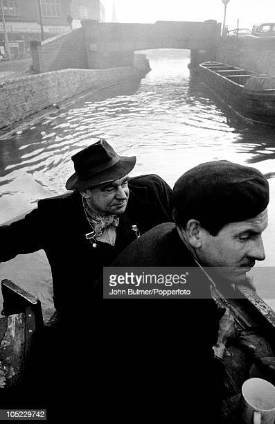 Two men bringing coal via canal in the Black Country, West Midlands, January 1961. The area was known for its coal mines and iron foundries.