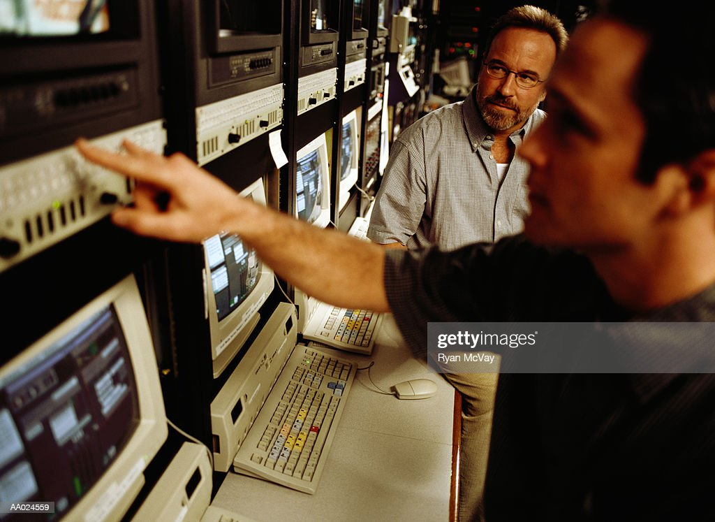 Two Men by a Digital Editing System : Stock Photo