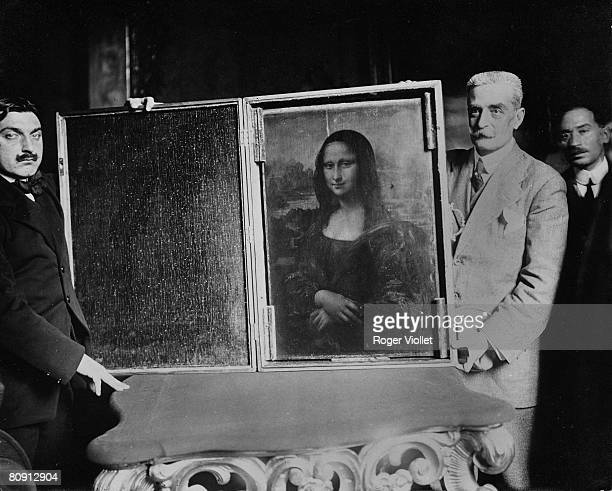 Two men carry the painting of the Mona Lisa back to the Louvre circa 1914 in Paris France Vincenzo Peruggia perpetrated what has been described as...