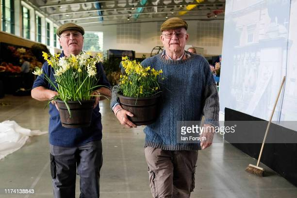 Two men carry their flowers to a display during staging day for the Harrogate Autumn Flower Show on September 12 2019 in Harrogate England The UK's...