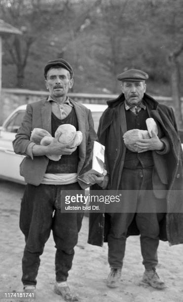 Two men carrying bread Earthquake in Gediz Turkey 1970