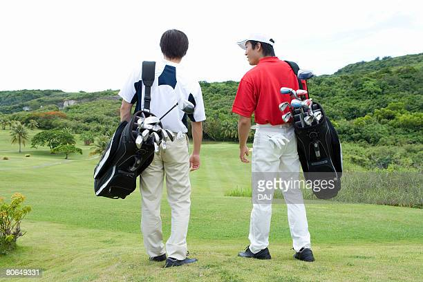 Two Men Carrying Golf Bag