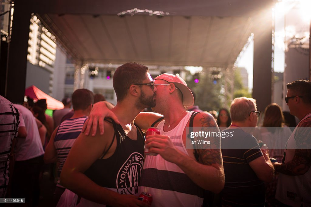 Two men celebrate along Church Street during the annual Gay Pride Festival on July 3, 2016 in Toronto, Ontario, Canada. Justin Trudeau made history as the first Canadian prime minister to march in the Pride parade.