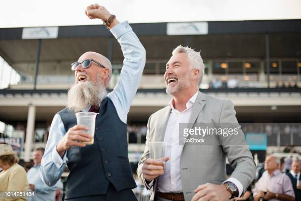 two men celebrating - newcastle races stock photos and pictures