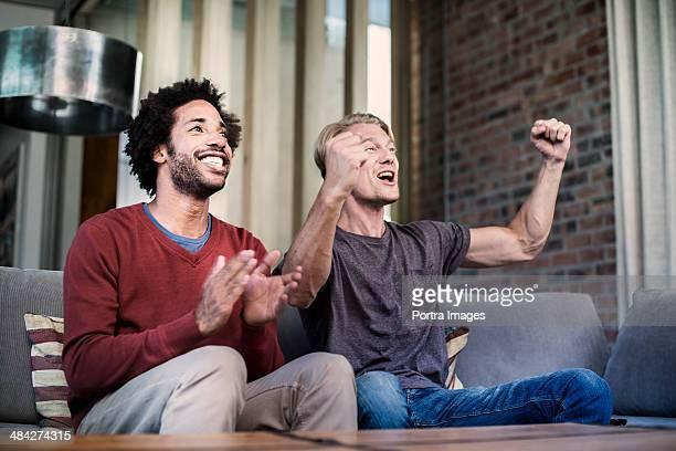 Two men celebrating their team