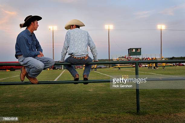 Two men chat before the start of the six man football matchup betweet the Patton Springs Rangers and the Guthrie Jaguars on October 11 2007 in...