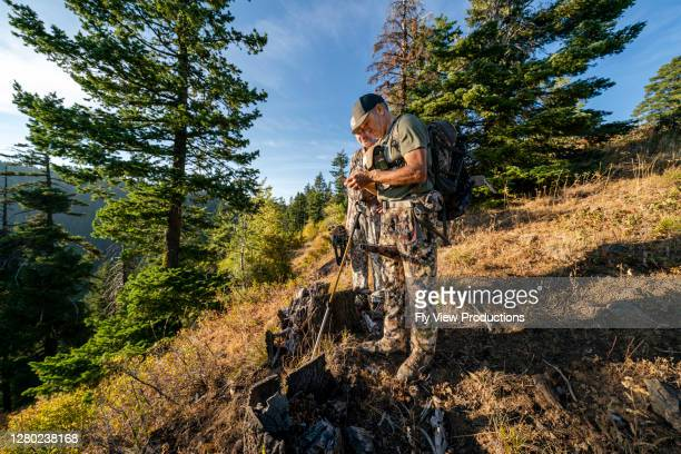 two men check navigation while hunting elk with crossbow - hunting stock pictures, royalty-free photos & images