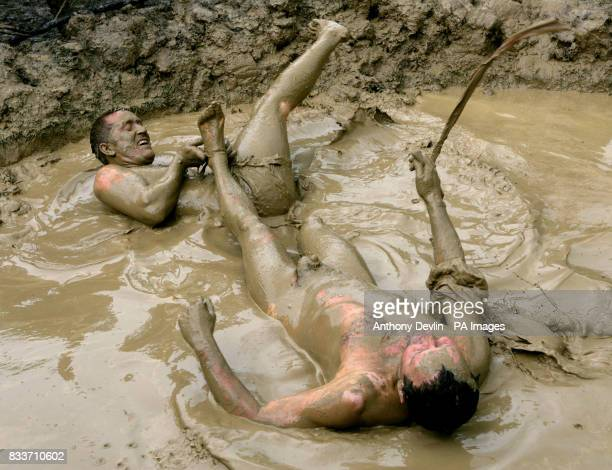 Two men compete in a mud wrestling contest at the 2007 Glastonbury Festival at Worthy Farm in Pilton Somerset PRESS ASSOCIATION Photo Sunday 24 June...