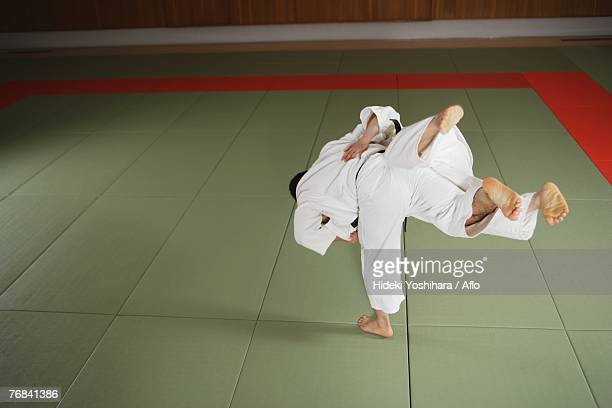 Two Men Competing in a Judo Match