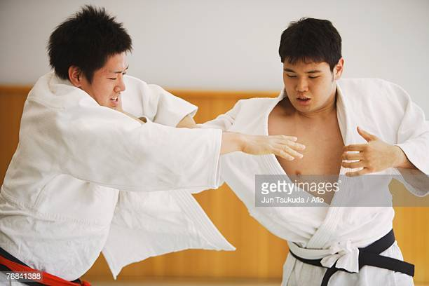 two men competing in a judo match - 柔道 ストックフォトと画像