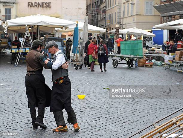 Two men dance Tango on Campo dei Fiori during the daily food market on January 13 2009 in Rome Campo dei Fiori means 'field of flowers' AFP PHOTO /...