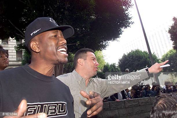 Two men demonstrate against members of a radio talk-show from Denver who destroyed O.J Simpson memorabilia, once belonging to the famous American...