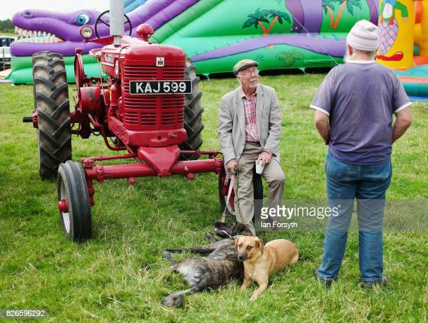 Two men discuss vintage tractors during the Osmotherley Country Show on August 5, 2017 in Osmotherley, England. The annual show hosts pony, cattle...