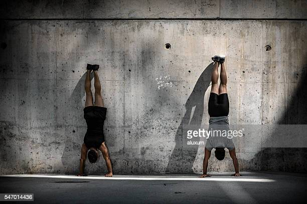 Two men doing headstands