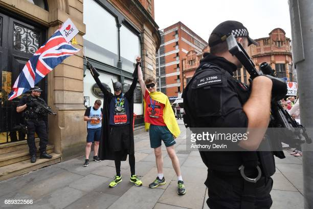 Two men dressed as Batman and Robin wave a Union flag close to the starting line during the Simplyhealth Great Manchester Run on May 28, 2017 in...