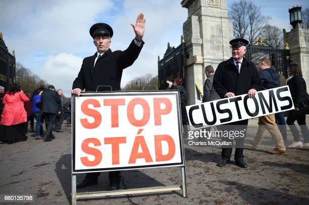 Two men dressed as customs officers take part in a protest outside Stormont against Brexit and its possible effect on the north and south Irish...