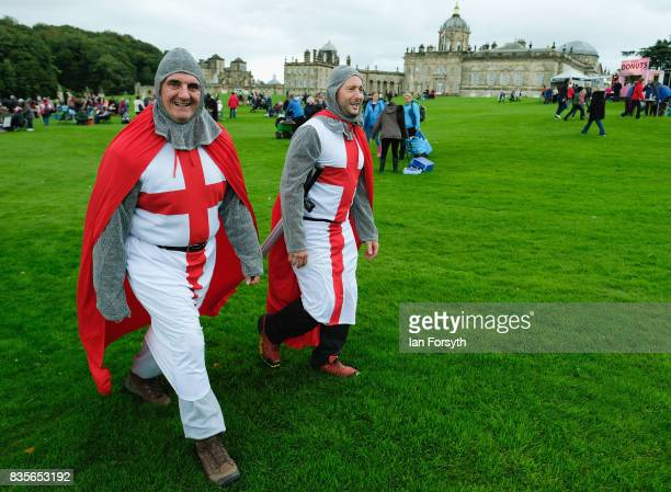 Two men dressed as knights attend the annual Castle Howard Proms Spectacular concert held on the grounds of the Castle Howard estate on August 19...