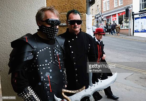 Two men dressed as steampunks stand on the street in Whitby during the Goth weekend on April 26 2014 in Whitby England The Whitby Goth weekend began...