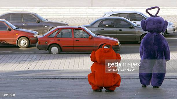 Two men dressed as Teletubbies popular characters of BBC children's program wait for kids in downtown Kiev 19 December 2003 to celebrate St Nickolay...